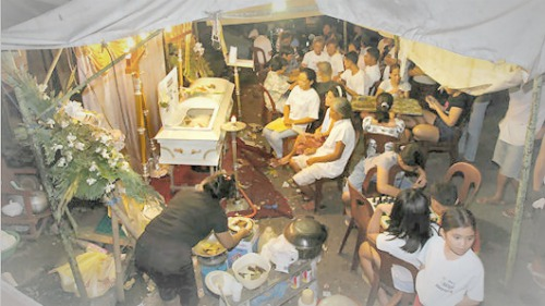A typical scene at a funeral wake in the Philippines
